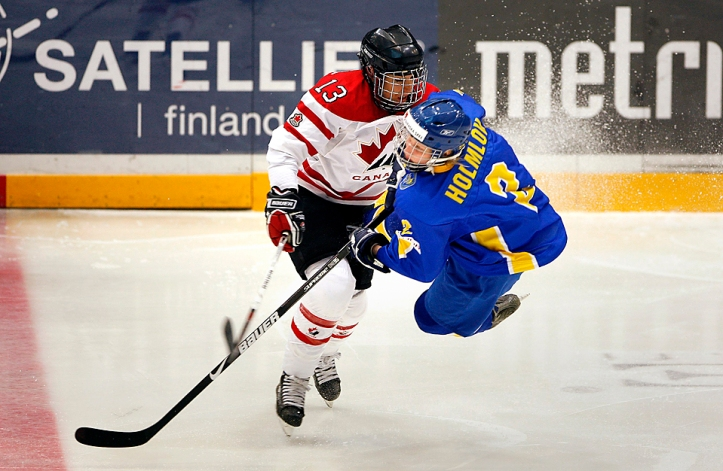Sweden's Holmlov collides with Canada's Ouellette during a round one game at the IIHF Women's World Ice Hockey Championships in Hameenlinna